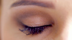 Close Up Shoot on Eye of Young Woman With Natural Makeup in Slow Motion - stock footage