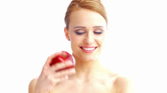 Hilarious Woman Holding Red Apple on White Background - stock footage