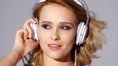 Adorable Blond Girl in Headphones Listen Music in Slow Motion - stock footage