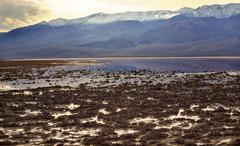 Badwater with black mountains death valley national park california Stock Photos
