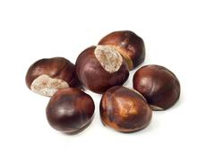 Autumn yield - pile of chestnuts Stock Photos
