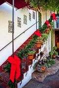 Steps and stairs christmas decorations red ribbons wreaths cactus old san die Stock Photos