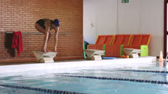 A female athlete diving Stock Footage