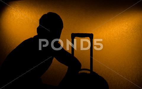 Stock photo of travel delay - silhouette of man