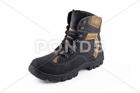 Stock photo of warm leather boot for wearing in winter or traveling isolated
