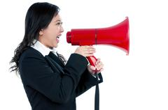 attractive businesswoman using megaphone - stock photo