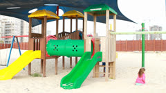 Lonely girl at children play yard Stock Footage