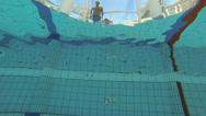 Stock Video Footage of A slow motion ramp effect of someone diving into a swimming pool