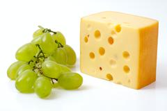 Cheese and grapes Stock Photos