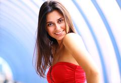 Beautiful young woman in a red dress Stock Photos