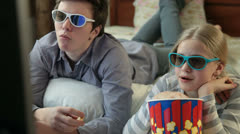 Watching 3D TV Movie at Home Stock Footage