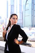 Business of the lady against skyscrapers Stock Photos