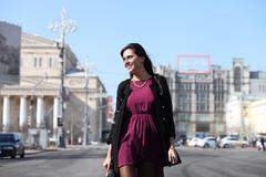 Stock Photo of walking woman in autumn moscow street
