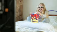 Stock Video Footage of Girl Watching 3D TV Movie - Emotions