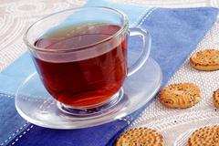 Cup of hot tea on a dark blue napkin Stock Photos