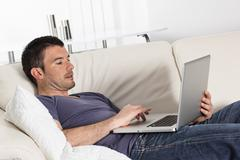 Stock Photo of computer on sofa