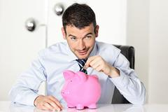 coin in piggy bang - stock photo