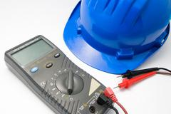 helmet and multimeter isolated - stock photo