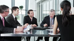 Diverse team of business people are having a meeting in a light, modern building Stock Footage
