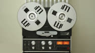 Stock Video Footage of Retro Audio tape recorder rewind the tape, slow motion HD
