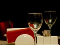 Restaurant - wineglasses and table appointments Stock Photos