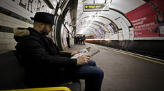 Time Lapse with a still man waiting for the train, underground of London Stock Footage