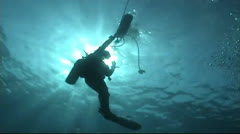 Diver in backlight` Stock Footage