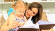 Young Caucasian Mom Daughter Photo Album Close Up Stock Footage