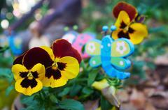 Wooden garden butterflies Stock Photos