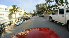 P.O.V. driving by restaurants on Ocean Drive Miami Florida, USA Stock Footage
