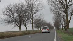 Road with car passing by Stock Footage
