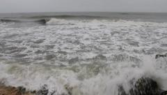 Foamy waves and agitated sea before the storm - stock footage