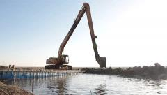 Water excavator building dam Stock Footage