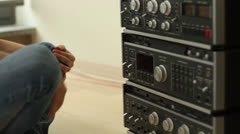 Girl listening to music from retro audio tape recorder  HD Stock Footage