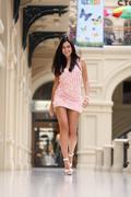 Stock Photo of beautiful young woman walking in the shop