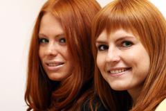 two young beautiful redhead women - stock photo