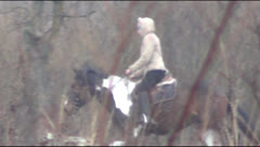 Stranger on a horse in a field Stock Footage