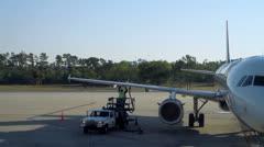 Mechanic Working on Plane Orlando Florida International Airport Stock Footage