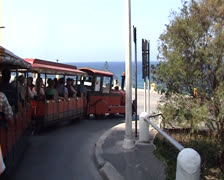 Tourist train going round a bend on a main road in Rhodes, Greece Stock Footage