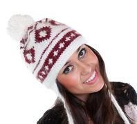 Young happy woman in a knitted hat Stock Photos
