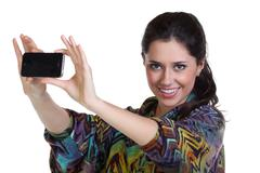 girl posing for a photograph taken from his cell phone - stock photo