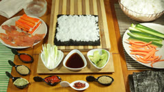 Making Sushi roll with sesame seeds Stock Footage