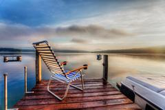 Chair at the end of the dock Stock Photos