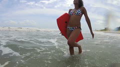 Girl Splashing Ocean Carrying Body Board Stock Footage