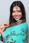Young pretty woman in indian turquoise sari Stock Photos