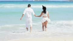 Carefree Caucasian Couple Running Ocean Shallows Stock Footage