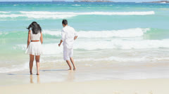 Happy Caucasian Couple Splashing Ocean Shallows Stock Footage