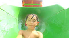 Young Boy Fun Riding Water Slide Stock Footage