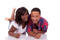 Happy young black african american couple lying down on the floor -- african  Stock Photos