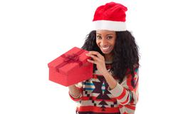young black african american woman opening a gift box - stock photo